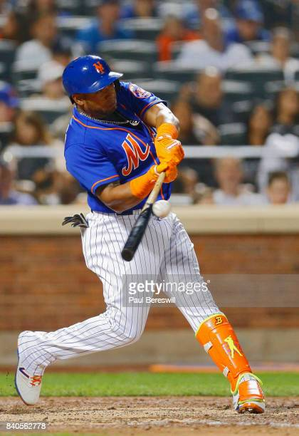 Yoenis Cespedes of the New York Mets bats in an MLB baseball game against the Miami Marlins on August 19 2017 at CitiField in the Queens borough of...