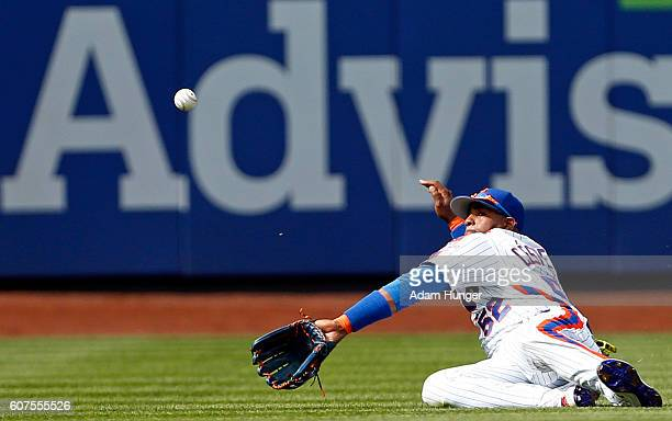 Yoenis Cespedes of the New York Mets can not make a catch during the fifth inning against the Minnesota Twins at Citi Field on September 18 2016 in...