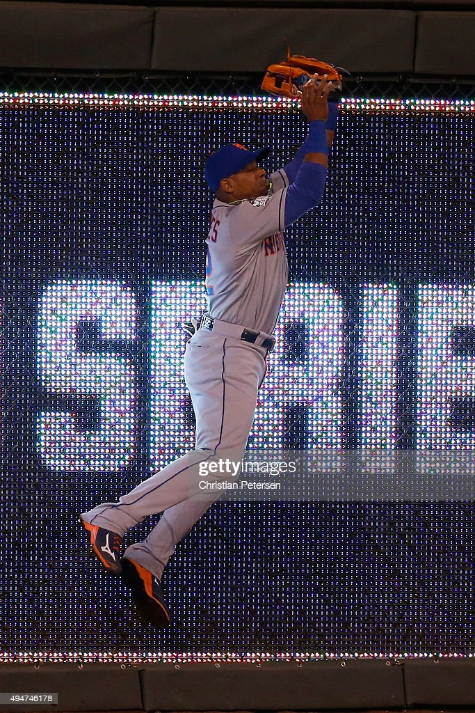 <a gi-track='captionPersonalityLinkClicked' href=/galleries/search?phrase=Yoenis+Cespedes&family=editorial&specificpeople=8892047 ng-click='$event.stopPropagation()'>Yoenis Cespedes</a> #52 of the New York Mets catches a ball hit by Alex Rios #15 of the Kansas City Royals (not pictured) at the wall in the sixth inning in Game Two of the 2015 World Series between the Kansas City Royals and the New York Mets at Kauffman Stadium on October 28, 2015 in Kansas City, Missouri.
