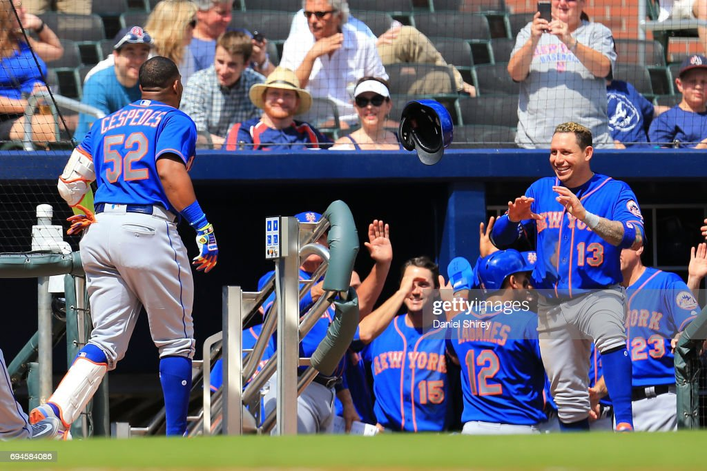 Yoenis Cespedes #52 of the New York Mets celebrates a grand slam with Asdrubal Cabrera #13 during the ninth inning against the Atlanta Braves at SunTrust Park on June 10, 2017 in Atlanta, Georgia.