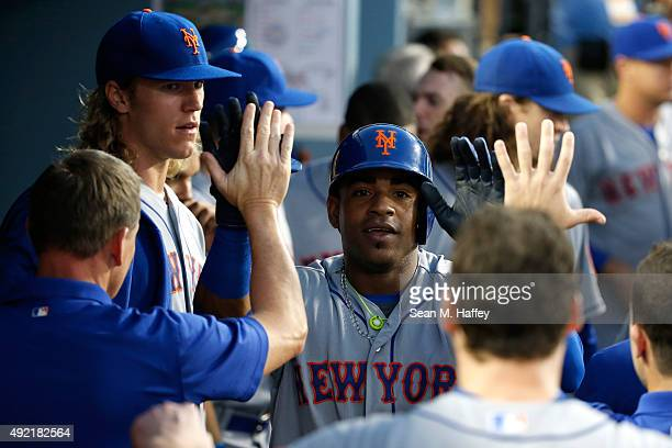 Yoenis Cespedes of the New York Mets celebrates after hitting a solo home run in the second inning against the Los Angeles Dodgers in game two of the...