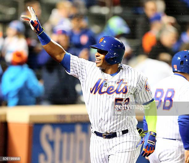 Yoenis Cespedes of the New York Mets celebrates as he heads for the dugout after he hit grand slam in the third inning against the San Francisco...