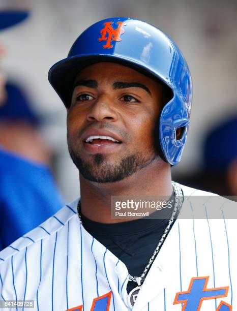 Yoenis Cespedes of the New York Mets celebrates his home run with teammates in the dugout in an MLB baseball game against the Miami Marlins on August...