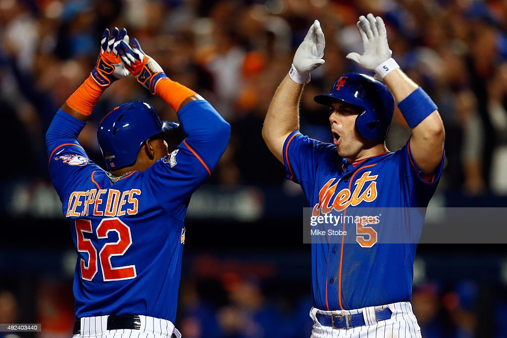 Yoenis Cespedes #52 of the New York Mets celebrates with David Wright #5 after hitting a three run home run against Alex Wood #57 of the Los Angeles Dodgers in the fourth inning during game three of the National League Division Series at Citi Field on October 12, 2015 in New York City.