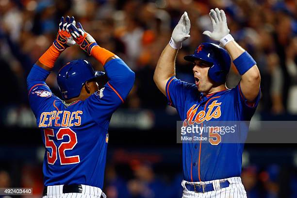 Yoenis Cespedes of the New York Mets celebrates with David Wright after hitting a three run home run against Alex Wood of the Los Angeles Dodgers in...