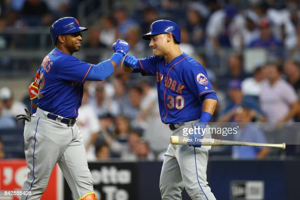 Yoenis Cespedes of the New York Mets celebrates with Michael Conforto after hitting a home run during the game against the New York Yankees at Yankee...