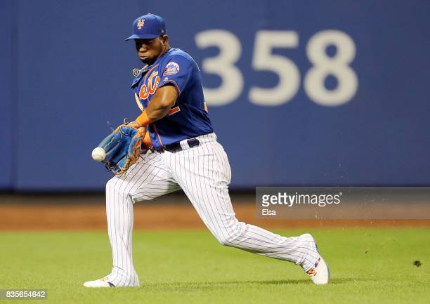 Yoenis Cespedes of the New York Mets chases down a hit by Marcell Ozuna of the Miami Marlins in the sixth inning on August 19 2017 at Citi Field in...