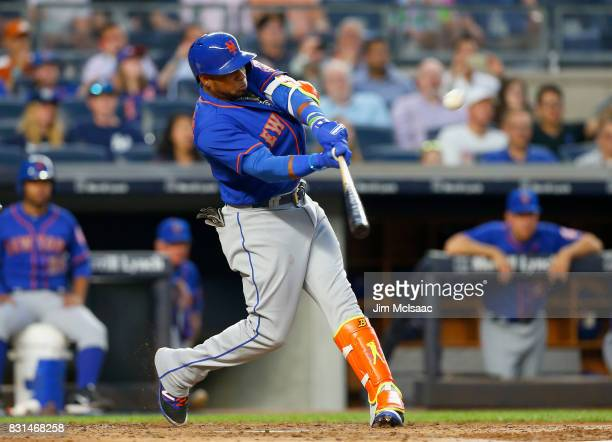 Yoenis Cespedes of the New York Mets connects on a third inning home run against the New York Yankees at Yankee Stadium on August 14 2017 in the...