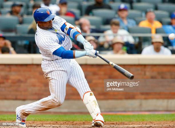 Yoenis Cespedes of the New York Mets connects on an eighth inning home run against the Washington Nationals at Citi Field on June 17 2017 in the...