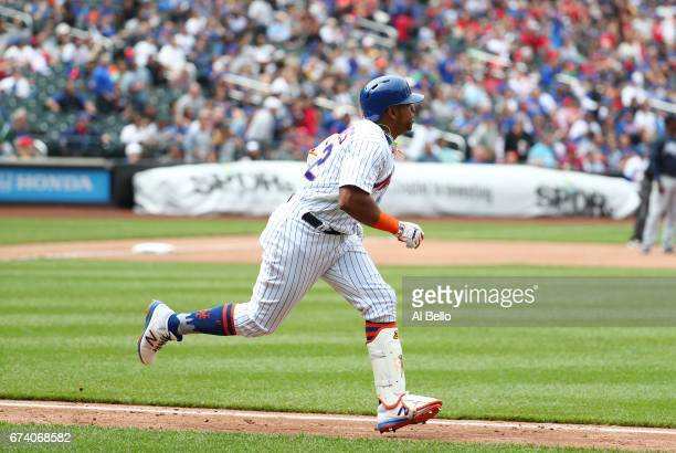 Yoenis Cespedes of the New York Mets doubles against the Atlanta Braves and injures his hamstring in the fourth inning during their game at Citi...