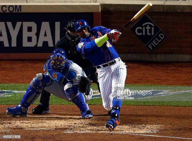 Yoenis Cespedes of the New York Mets fouls the ball off of his leg in the sixth inning against the Kansas City Royals during Game Five of the 2015...