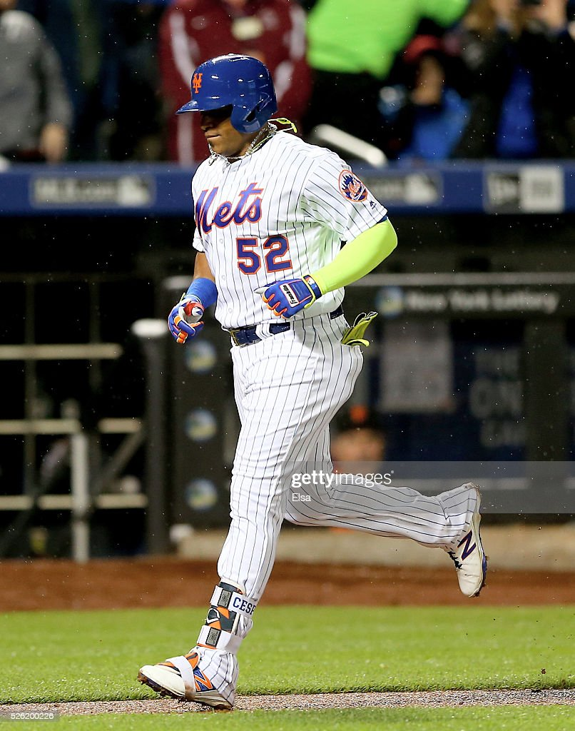 <a gi-track='captionPersonalityLinkClicked' href=/galleries/search?phrase=Yoenis+Cespedes&family=editorial&specificpeople=8892047 ng-click='$event.stopPropagation()'>Yoenis Cespedes</a> #52 of the New York Mets heads home after he hit a grand slam in the third inning against the San Francisco Giants at Citi Field on April 29, 2016 in the Flushing neighborhood of the Queens borough of New York City.