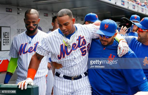 Yoenis Cespedes of the New York Mets helped to the locker room after an injury against the Atlanta Braves at Citi Field on April 27 2017 in the...