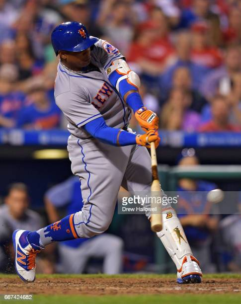 Yoenis Cespedes of the New York Mets hits a double in the seventh inning against the Philadelphia Phillies at Citizens Bank Park on April 11 2017 in...