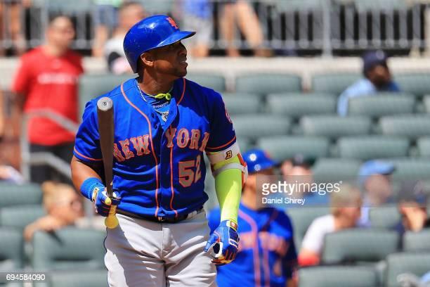 Yoenis Cespedes of the New York Mets hits a grand slam during the ninth inning against the Atlanta Braves at SunTrust Park on June 10 2017 in Atlanta...
