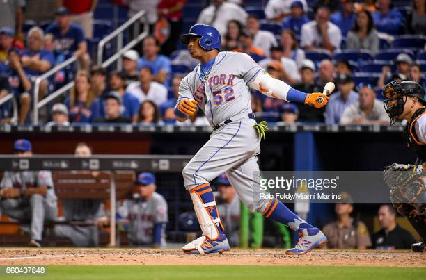 Yoenis Cespedes of the New York Mets hits a home run during the game against the Miami Marlins at Marlins Park on April 14 2017 in Miami Florida