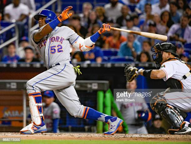 Yoenis Cespedes of the New York Mets hits a home run in the third inning against the Miami Marlins at Marlins Park on April 13 2017 in Miami Florida