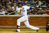 Yoenis Cespedes of the New York Mets hits a thirdinning home run against the Miami Marlins at Citi Field on September 14 2015 in the Flushing...
