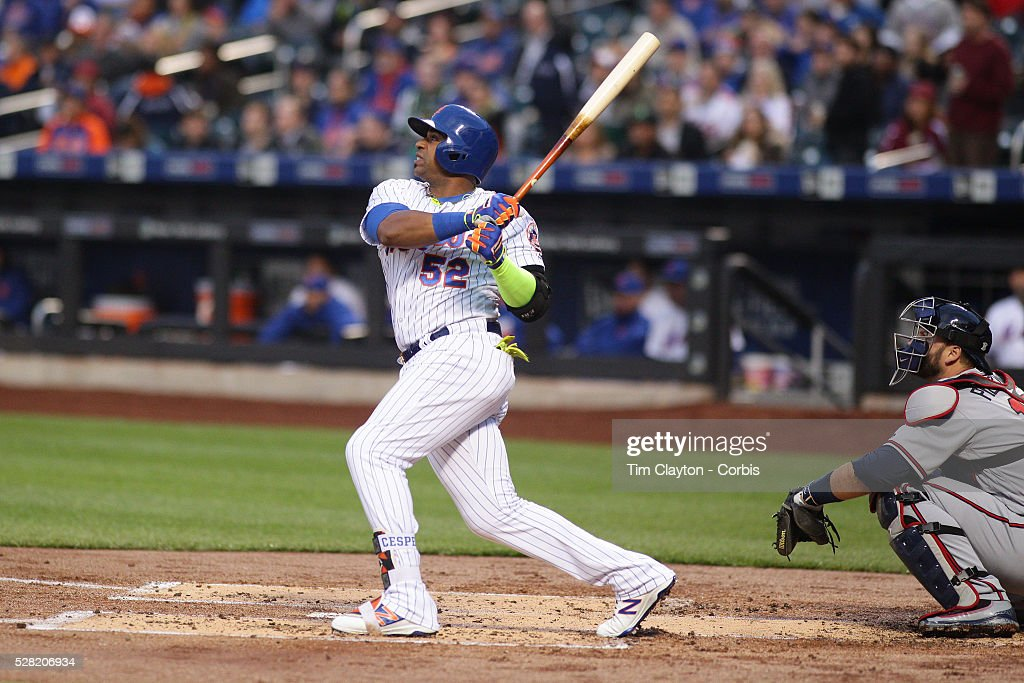<a gi-track='captionPersonalityLinkClicked' href=/galleries/search?phrase=Yoenis+Cespedes&family=editorial&specificpeople=8892047 ng-click='$event.stopPropagation()'>Yoenis Cespedes</a> #52 of the New York Mets hits a two run home run in the first inning off Mike Foltynewicz #26 of the Atlanta Braves during the Atlanta Braves Vs New York Mets MLB regular season game at Citi Field on May 02, 2016 in New York City.