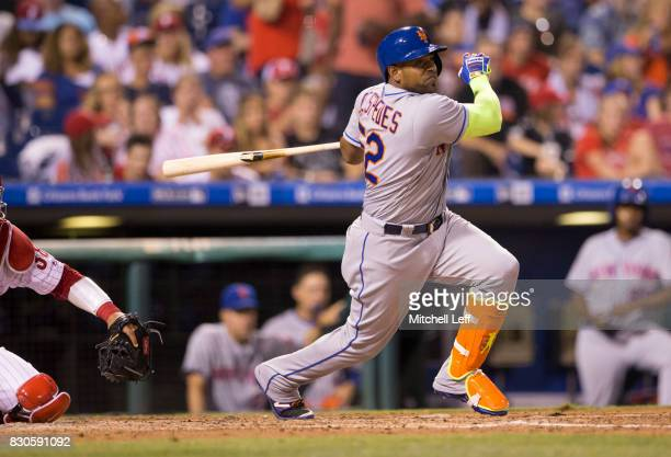 Yoenis Cespedes of the New York Mets hits an RBI single in the top of the fifth inning against the Philadelphia Phillies at Citizens Bank Park on...
