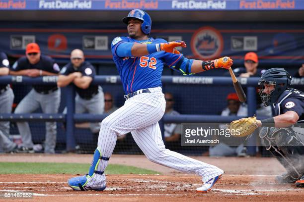 Yoenis Cespedes of the New York Mets hits the ball against the Detroit Tigers in the first inning during a spring training game at First Data Field...