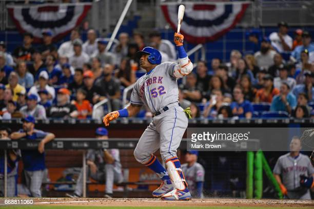 Yoenis Cespedes of the New York Mets in action during the game against the Miami Marlins at Marlins Park on April 13 2017 in Miami Florida