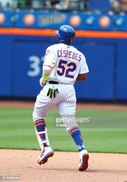 Yoenis Cespedes of the New York Mets injures his hamstring after hitting a double in the fourth inning against the Atlanta Braves during their game...
