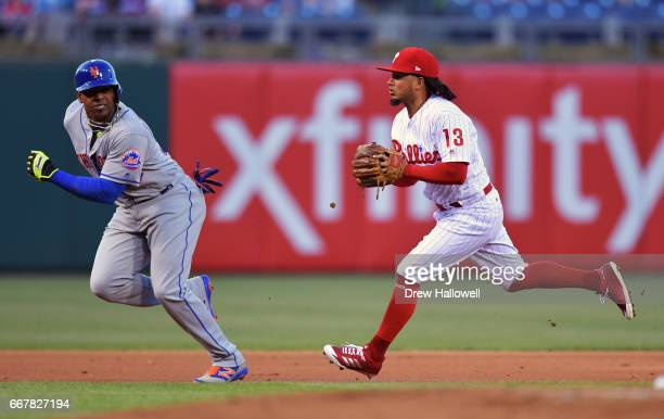 Yoenis Cespedes of the New York Mets is chased down by Freddy Galvis of the Philadelphia Phillies for an out in the first inning at Citizens Bank...