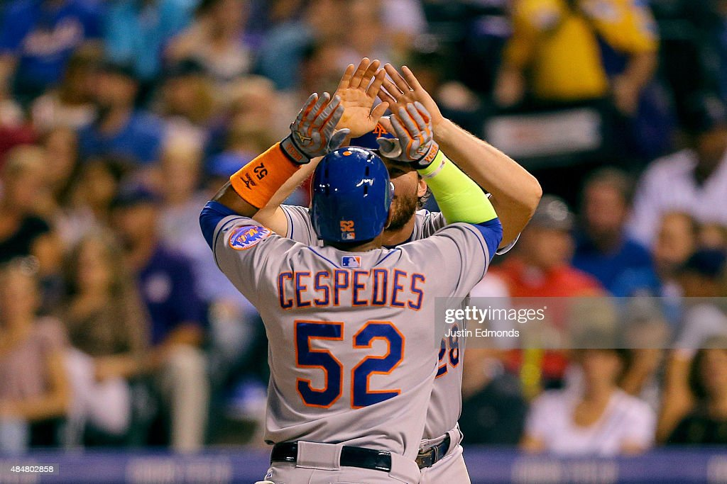 Yoenis Cespedes #52 of the New York Mets is congratulated by <a gi-track='captionPersonalityLinkClicked' href=/galleries/search?phrase=Daniel+Murphy+-+Baseball&family=editorial&specificpeople=8610809 ng-click='$event.stopPropagation()'>Daniel Murphy</a> #28 after hitting his third home run of the game, a three run shot, during the sixth inning against the Colorado Rockies at Coors Field on August 21, 2015 in Denver, Colorado.