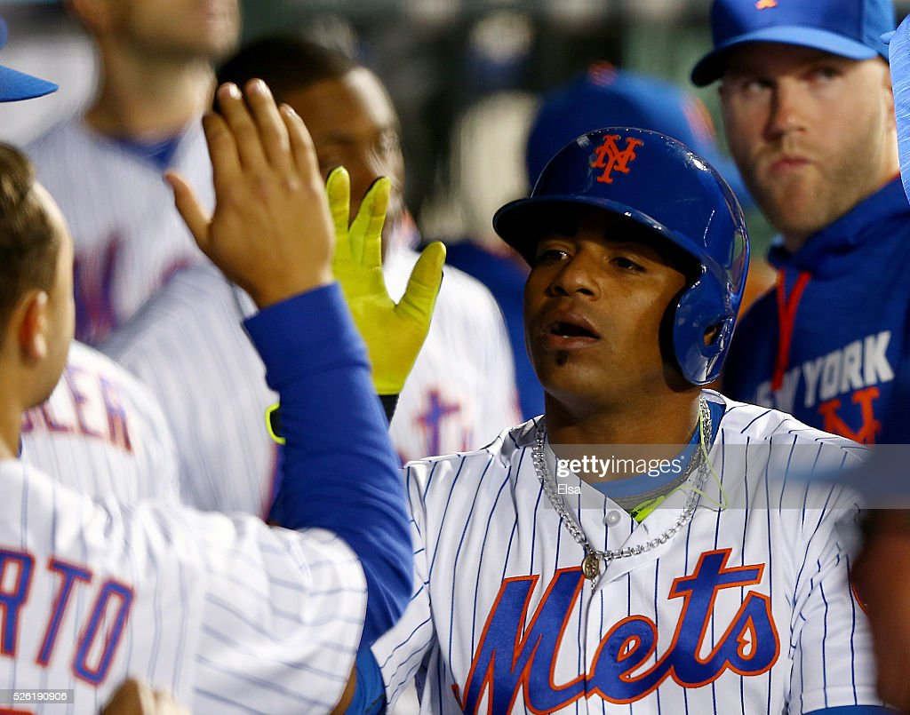 <a gi-track='captionPersonalityLinkClicked' href=/galleries/search?phrase=Yoenis+Cespedes&family=editorial&specificpeople=8892047 ng-click='$event.stopPropagation()'>Yoenis Cespedes</a> #52 of the New York Mets is congratulated by teammates in the dugout after he scored a run in the third inning against the San Francisco Giants at Citi Field on April 29, 2016 in the Flushing neighborhood of the Queens borough of New York City.