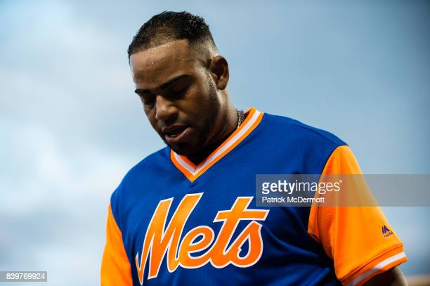 Yoenis Cespedes of the New York Mets is helped off the field after an apparent leg injury in the first inning against the Washington Nationals at...