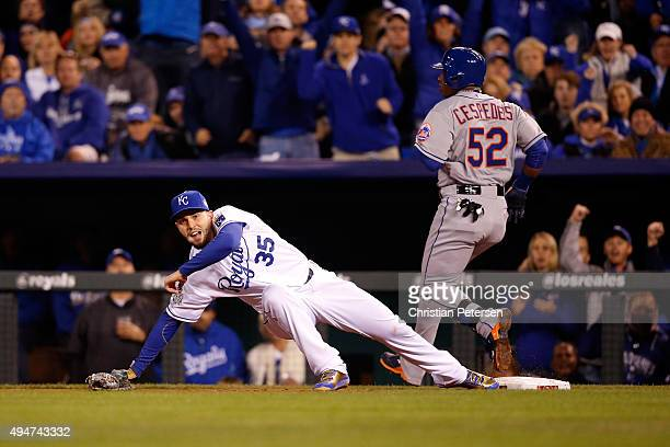 Yoenis Cespedes of the New York Mets is safe at first base as Eric Hosmer of the Kansas City Royals attempts to force him out in the fourth inning in...