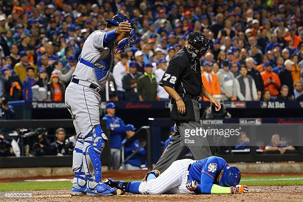 Yoenis Cespedes of the New York Mets lies on the ground after fouling the ball off of his leg in the sixth inning against the Kansas City Royals...
