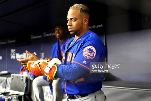 Yoenis Cespedes of the New York Mets prepares in the dugout during the game against the New York Yankees at Yankee Stadium on Monday August 14 2017...