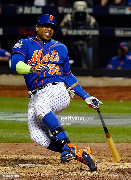 Yoenis Cespedes of the New York Mets reacts as he fouls the ball off of his leg in the sixth inning against the Kansas City Royals during Game Five...