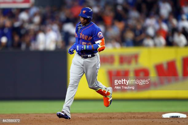 Yoenis Cespedes of the New York Mets rounds the bases after hitting a home run during the game against the New York Yankees at Yankee Stadium on...