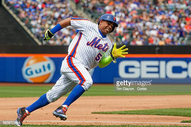 Yoenis Cespedes of the New York Mets rounds third base to score on a Asdrubal Cabrera single in the fourth inning which also scored Michael Conforto...