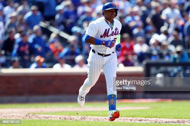 Yoenis Cespedes of the New York Mets runs to first base during the game between the Atlanta Braves and New York Mets at Citi Field on Monday April 3...
