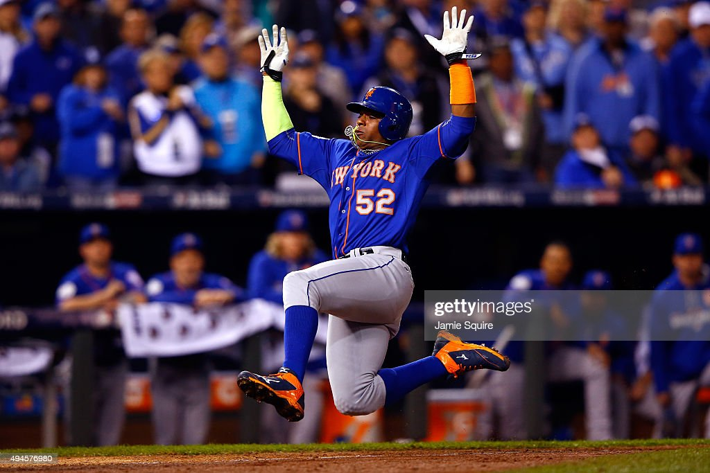 Yoenis Cespedes #52 of the New York Mets scores a run in the sixth inning against the Kansas City Royals during Game One of the 2015 World Series at Kauffman Stadium on October 27, 2015 in Kansas City, Missouri.