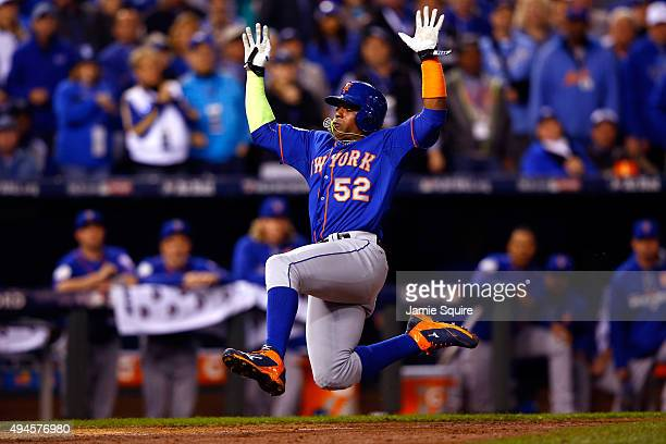 Yoenis Cespedes of the New York Mets scores a run in the sixth inning against the Kansas City Royals during Game One of the 2015 World Series at...