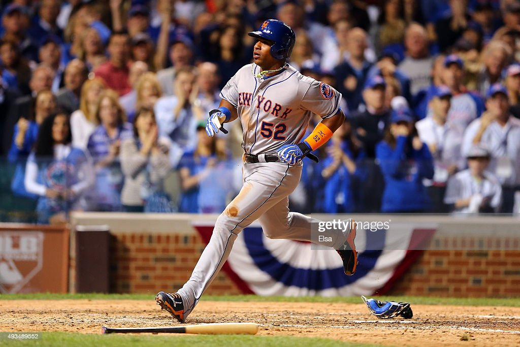 Yoenis Cespedes #52 of the New York Mets scores a run off of a wild pitch thrown by Trevor Cahill #53 of the Chicago Cubs in the sixth inning during game three of the 2015 MLB National League Championship Series at Wrigley Field on October 20, 2015 in Chicago, Illinois.