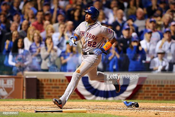 Yoenis Cespedes of the New York Mets scores a run off of a wild pitch thrown by Trevor Cahill of the Chicago Cubs in the sixth inning during game...