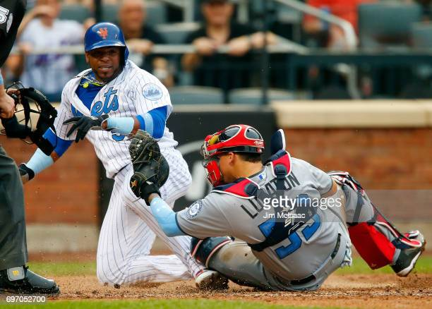 Yoenis Cespedes of the New York Mets scores on a sixth inning sacrifice fly past Jose Lobaton of the Washington Nationals at Citi Field on June 17...