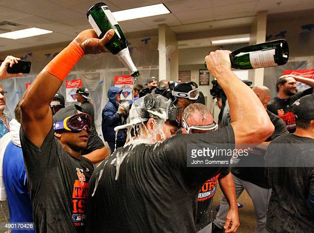 Yoenis Cespedes of the New York Mets sprays champagne as they celebrate in the clubhouse after defeating the Cincinnati Reds 102 to clinch the...