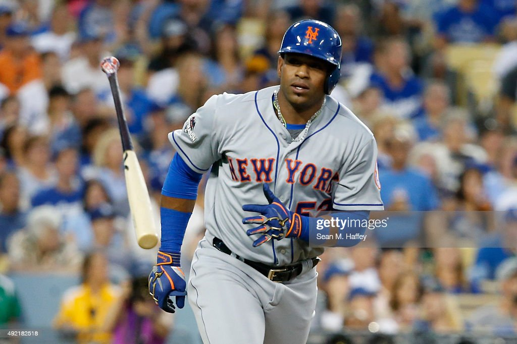 Yoenis Cespedes #52 of the New York Mets throws his bat after hitting a solo home run in the second inning against the Los Angeles Dodgers in game two of the National League Division Series at Dodger Stadium on October 10, 2015 in Los Angeles, California.
