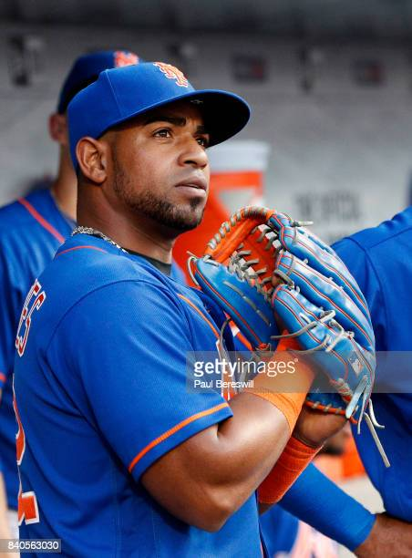 Yoenis Cespedes of the New York Mets waits to go onto the field in the first inning in an MLB baseball game against the Miami Marlins on August 19...
