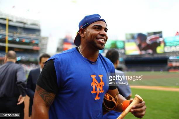 Yoenis Cespedes of the New York Mets walks on the field during batting practice ahead of the game against the New York Yankees at Yankee Stadium on...