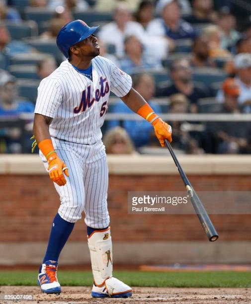 Yoenis Cespedes of the New York Mets watches his fly ball in an interleague MLB baseball game against the New York Yankees on August 16 2017 at...