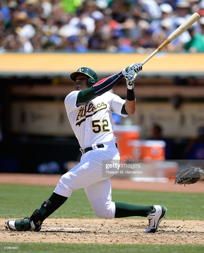 Yoenis Cespedes #52 of the Oakland Athletics bats against the Chicago Cubs at O.co Coliseum on July 4, 2013 in Oakland, California.