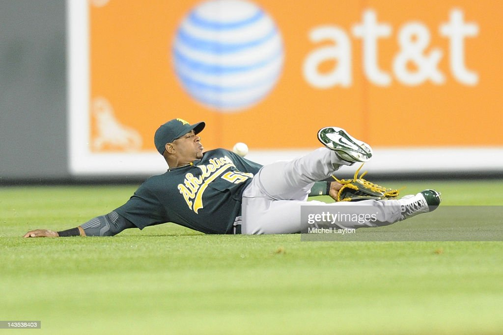 <a gi-track='captionPersonalityLinkClicked' href=/galleries/search?phrase=Yoenis+Cespedes&family=editorial&specificpeople=8892047 ng-click='$event.stopPropagation()'>Yoenis Cespedes</a> #52 of the Oakland Athletics can not catch a hit by Ronny Paulino #26 of the Baltimore Orioles during the second inning a baseball game at Oriole Park at Camden Yards on April 28, 2012 in Baltimore, Maryland.